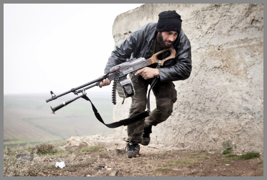 Free Syrian Army fighter takes cover during fighting with the Syrian Army
