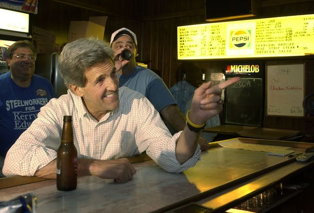 Sen. John Kerry, D-Mass., drinks a beer while visiting with locals at Abdalla's Tavern