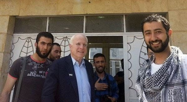 "Sen. John McCain poses with a few of his ""Heroes"""