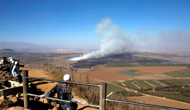 Druze men watch Syrian Air Force bomb ISIS-Al Nusrah positions
