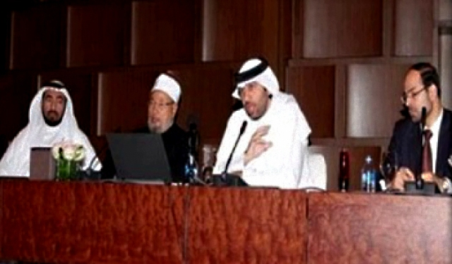 CAIR's Nihad Awad (far right) and Qaradawi (second from left).