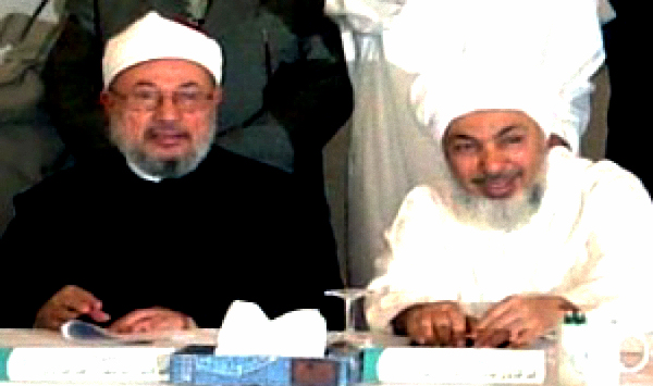 Muslim Brotherhood Spiritual leader Yusuf al-Qaradawi (L) and his Deputy Abdallah bin Bayyah (R)