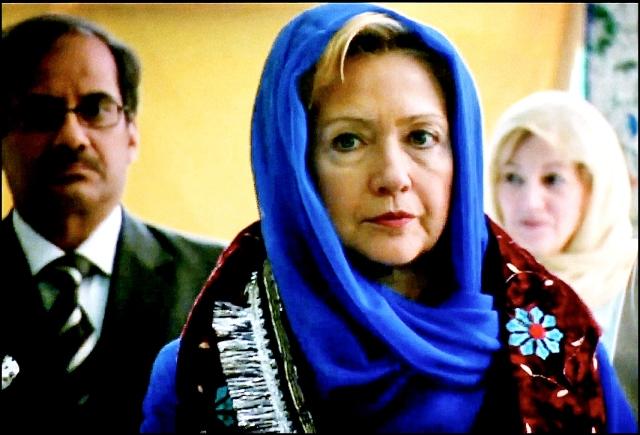 Hillary joins her Islamic benefactors in solemn prayer to Allah.